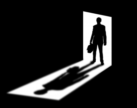 18476681 - silhouette of coming businessman in doorway with shadow