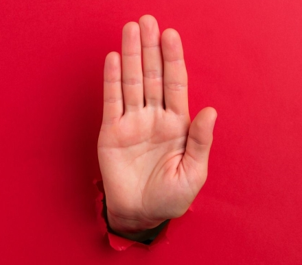 "Human hand showing ""stop sign"""